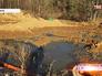 Канализационные стоки из новых домов выведены в выгребную яму