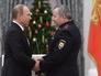 Президент России Владимир Путин награждает званием Героя РФ майора полиции Абубакара Костоева