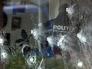 Пулевые отверстия в стекле