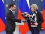 Председатель правительства России Дмитрий Медведев и режиссер Татьяна Ильина