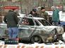 Сотрудники полиции около взорванной машины ДПС