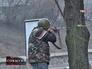 Активист ведет стрельбу во время беспорядка в Киеве