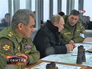 Владимир Путин и Сергей Шойгу наблюдают за военными учениями