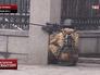 Снайпер ведет стрельбу во время беспорядков в Киеве