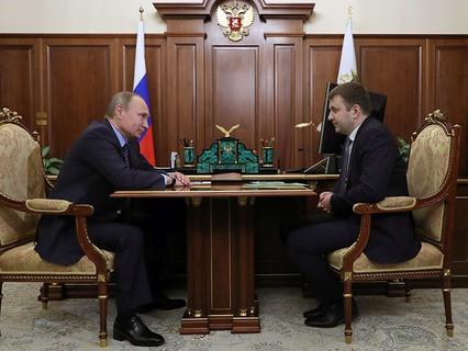 Владимир Путин и заместитель министра финанасов Максим Орешкин