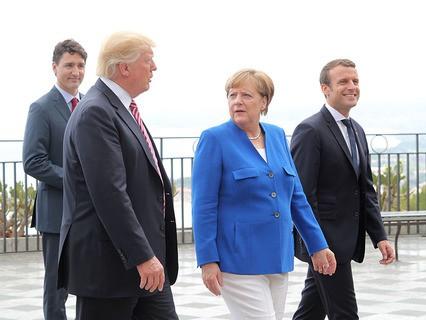 Президент США Дональд Трамп, канцлер Германии Ангела Меркель и президент Франции Эммануэль Макрон