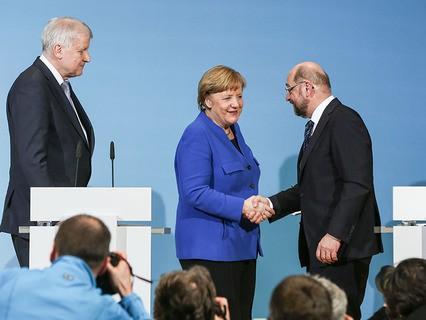 Лидеры ведущих партий Германии Ангела Меркель и Мартин Шульц смогли наконец сблизить свои позиции
