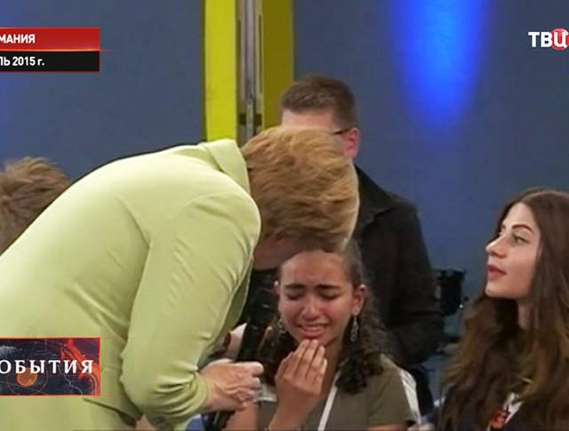 Разрыдавшаяся перед Ангелой Меркель девочка