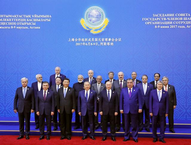 Участники заседания Совета глав государств – членов Шанхайской организации сотрудничества (ШОС) в расширенном составе