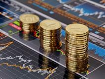 Столбики монет на финансовых графиках