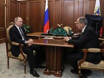 Владимир Путин и министр иностранных дел РФ Сергей Лавров
