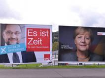 Плакаты с Мартином Шульцем и Ангелой Меркель