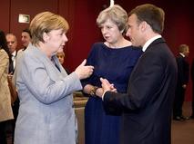 Канцлер Германии Ангела Меркель, премьер-министр Великобритании Тереза Мэй и президент Франции Эммануэль Макрон