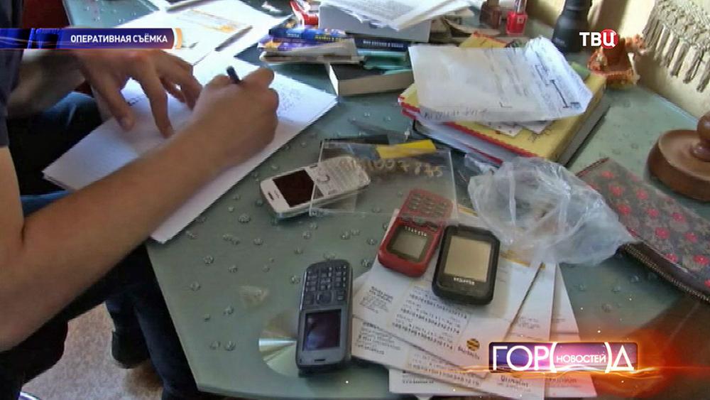 Изъятые телефоны у мошенников