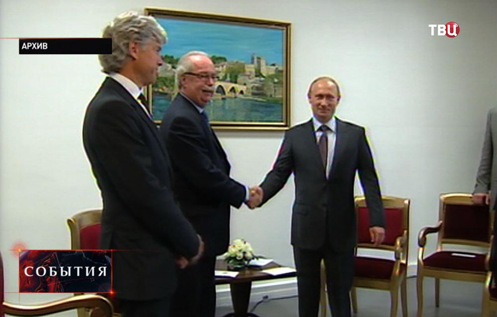 Президент России Владимир Путин и президент нефтяной компании Total Кристоф де Маржери