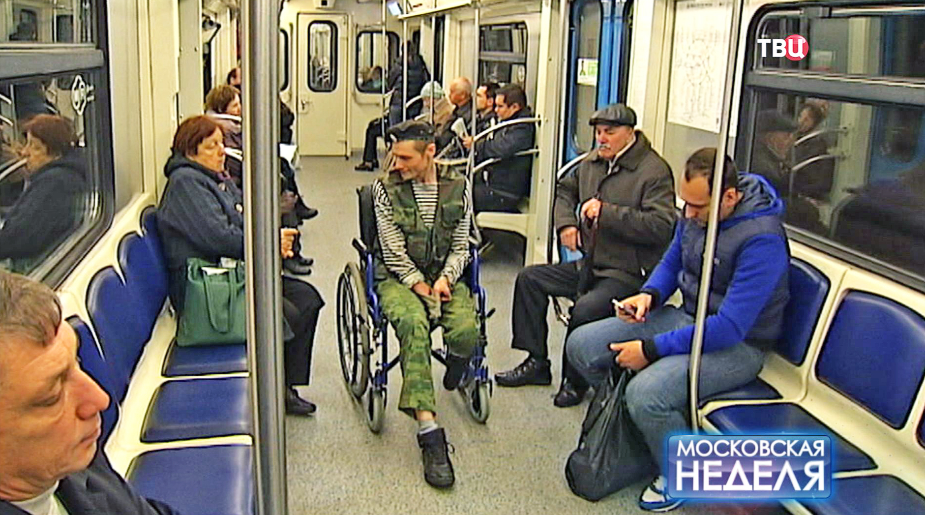 Попрошайка в вагоне метро