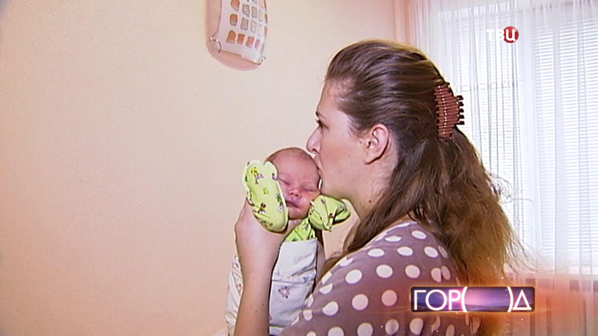 Мать с новорожденным