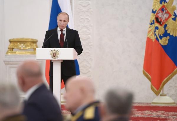 Президент России Владимир Путин выступает на торжественном приеме по случаю Дня Героев Отечества