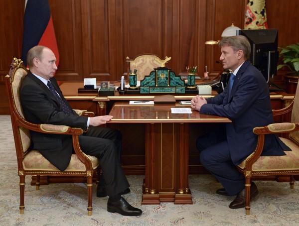 Президент России Владимир Путин и председатель правления Сбербанка РФ Герман Греф во время встречи
