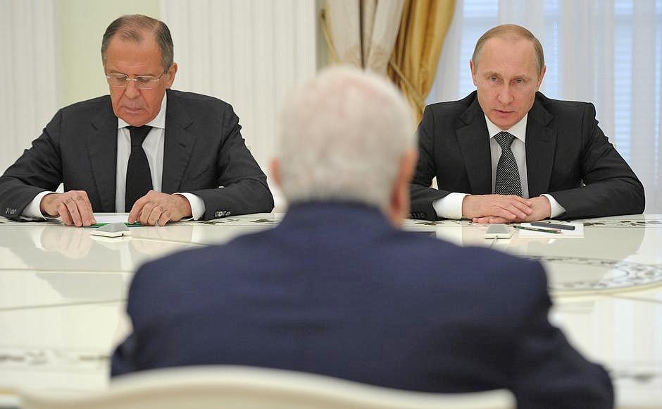 Глава МИД РФ Сергей Лавров и президент России Владимир Путин и министр иностранных дел Сирийской Арабской Республики Валид Муаллем
