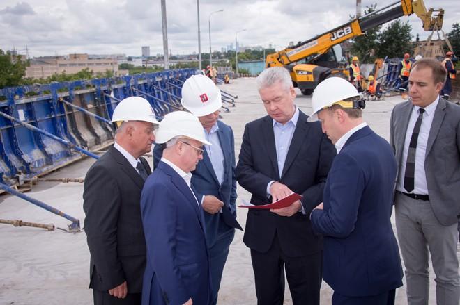 Сергей Собянин на строительстве развязки на Волгоградском проспекте