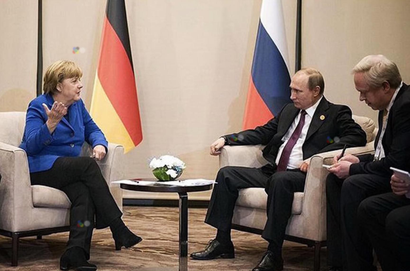 Президент России Владимир Путин и канцлер Германии Ангела Меркель на саммите G20