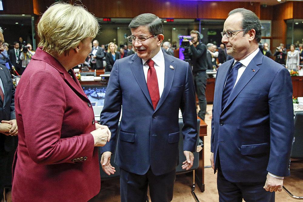 Ангела Меркель, Ахмет Давутоглу и Франсуа Олланд