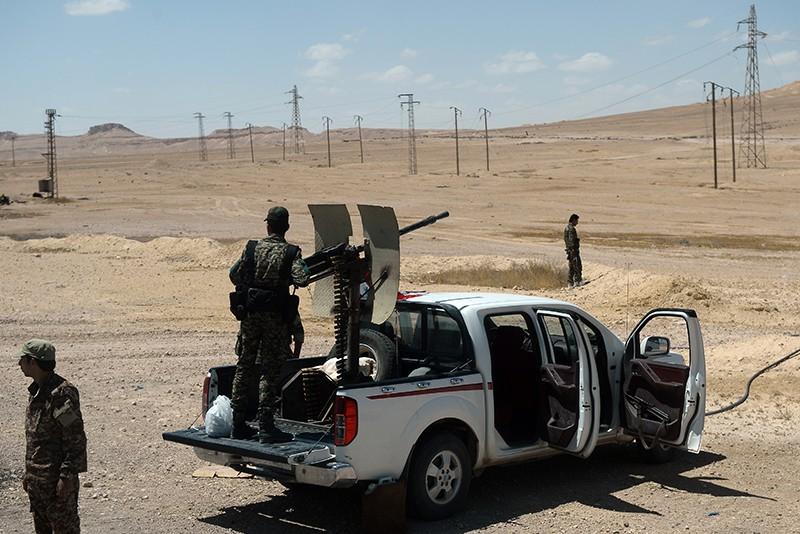 Военнослужащие сирийской армии на блокпосту