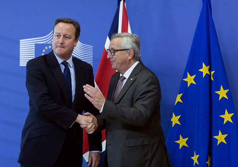Премьер-министр Великобритании Дэвид Кэмерон и председатель Европейской комиссии Жан-Клод Юнкер