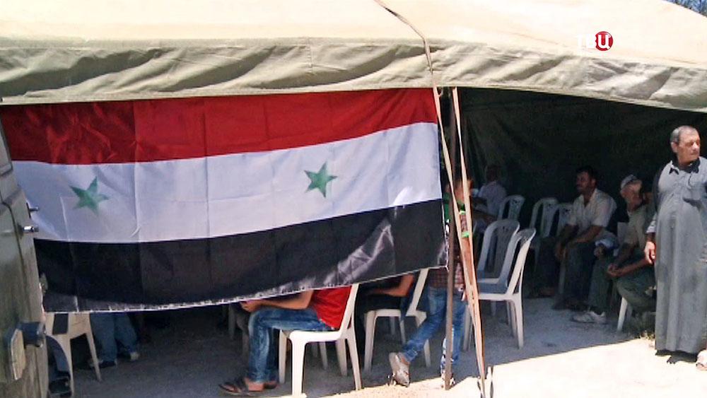 Палаточный лагерь беженцев в Сирии