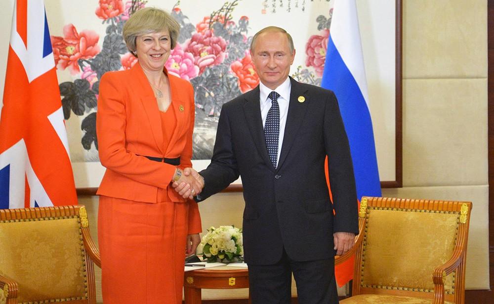Президент России Владимир Путин и премьер-министр Великобритании Тереза Мэй