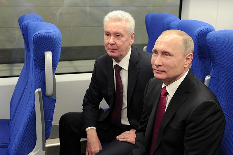 Президент России Владимир Путин и мэр Москвы Сергей Собянин принимают участие в церемонии ввода в эксплуатацию транспортного Московского центрального кольца