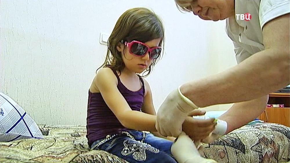 В военный госпиталь доставили детей из Сирии