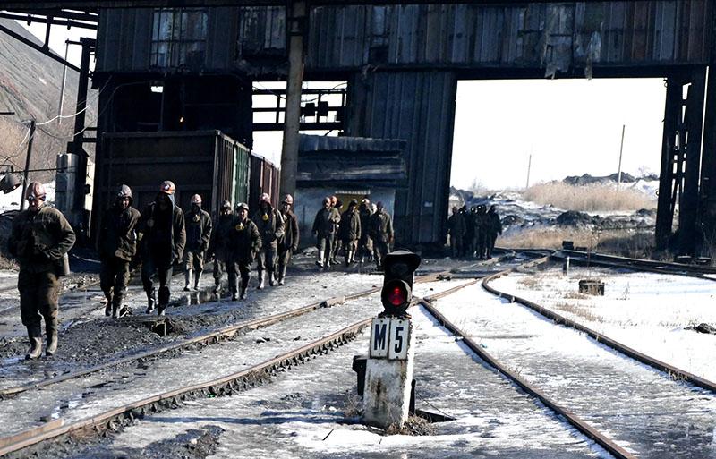 Рабочие на угольной шахте