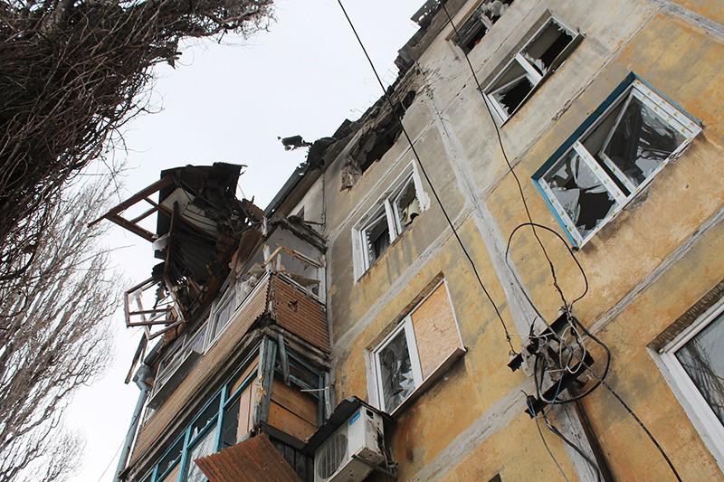 Дом, пострадавший в результате обстрела украинскими силовиками
