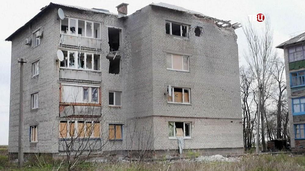 Последствия обстрелов жилых кварталов Донбасса