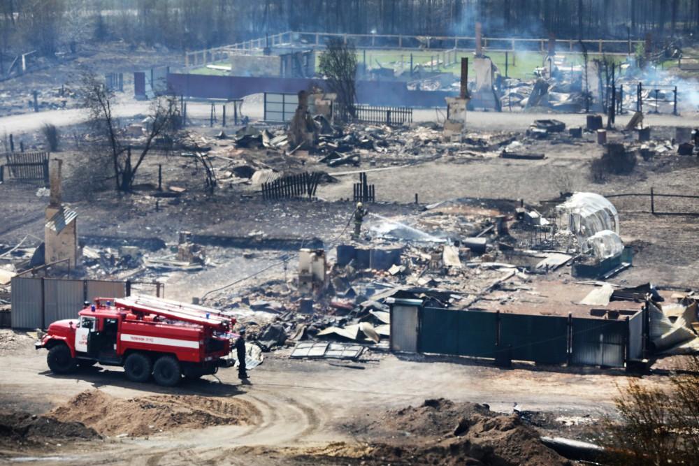 Пострадавший от лесных пожаров поселок