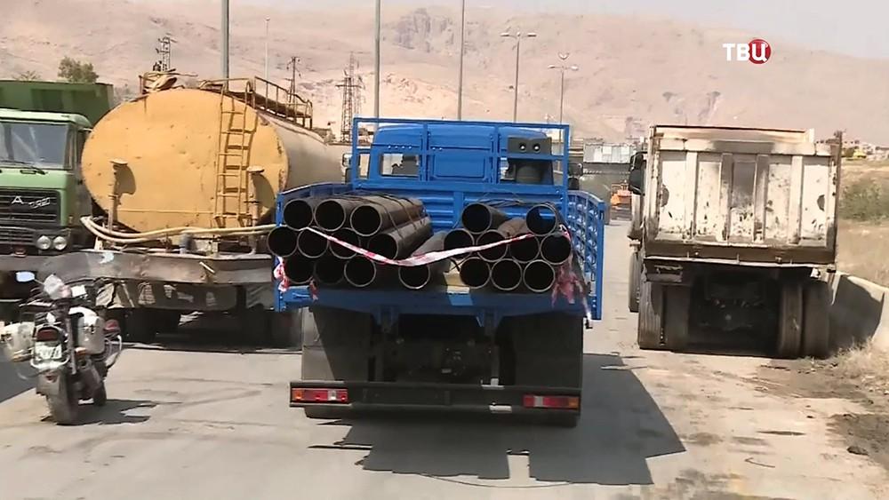 Стройматериалы в грузовике в Сирии