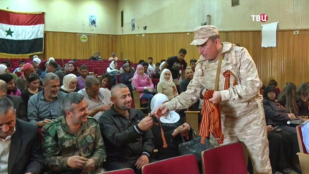 Жителям Сирии раздали георгиевские ленточки