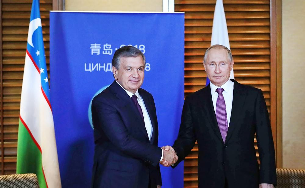 Президент России России Владимир Путин и президент Узбекистана Шавкат Мирзиёев