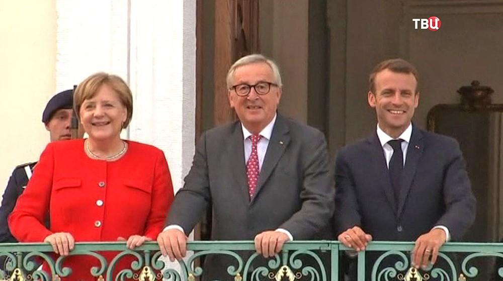 Канцлер ФРГ Ангела Меркель, Жан-Клод Юнкер и президент Франции Эммануэль Макрон