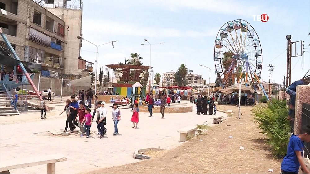 Парк аттракционов в городе Дума, Сирия