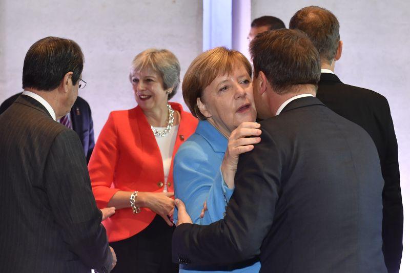 Ангела Меркель, лидеры стран Евросоюза и Тереза Мэй