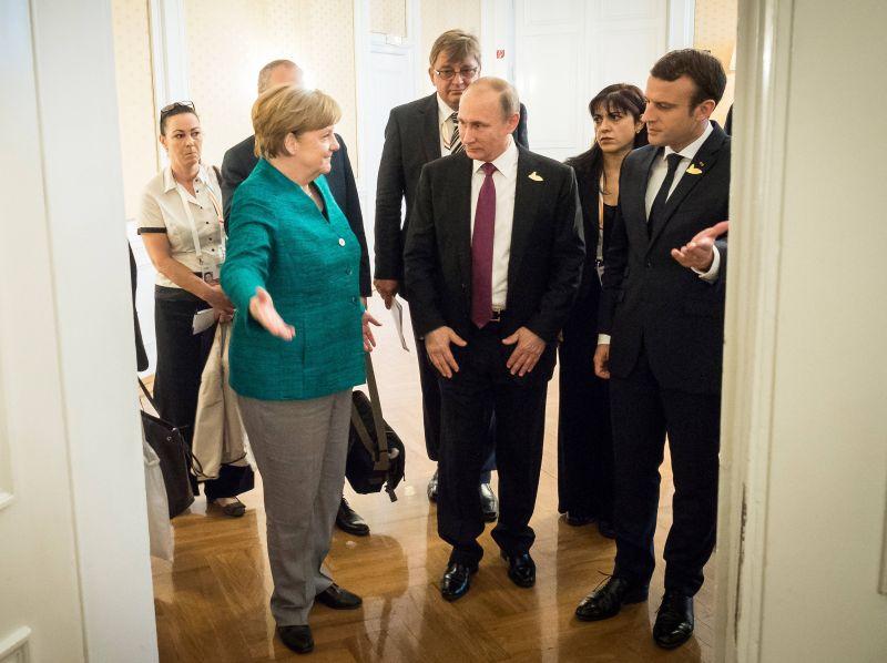 Ангела Меркель, Владимир Путин и Эмманюэль Макрон
