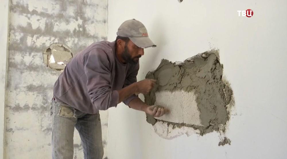 Восстановление жилых домов в Сирии