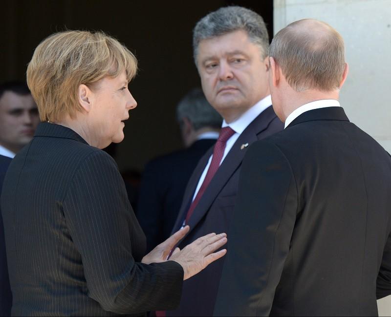 Президент России Владимир Путин, президент Украины Петр Порошенко и канцлер Германии Ангела Меркель