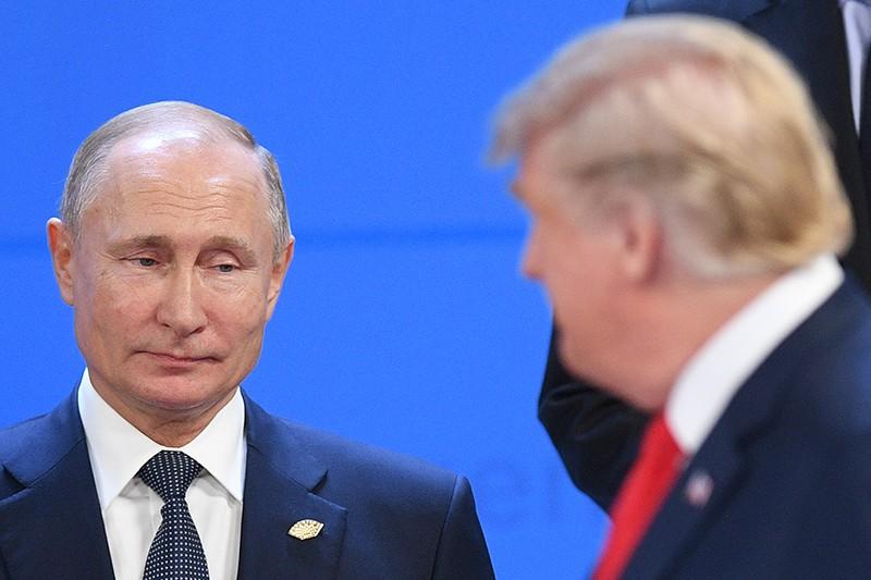 Президент России Владимир Путин и президент США Дональд Трамп на саммите G20