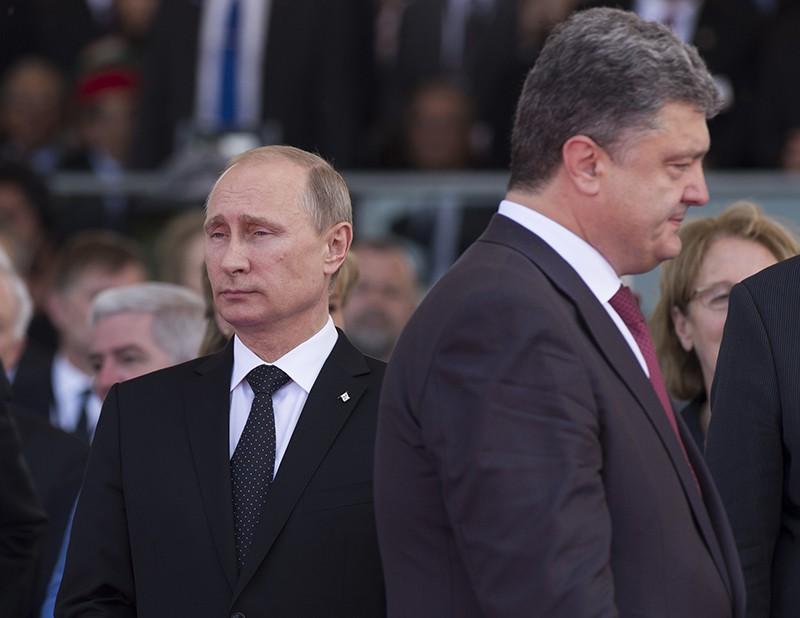 Президент России Владимир Путин и президент Украины Петр Порошенко