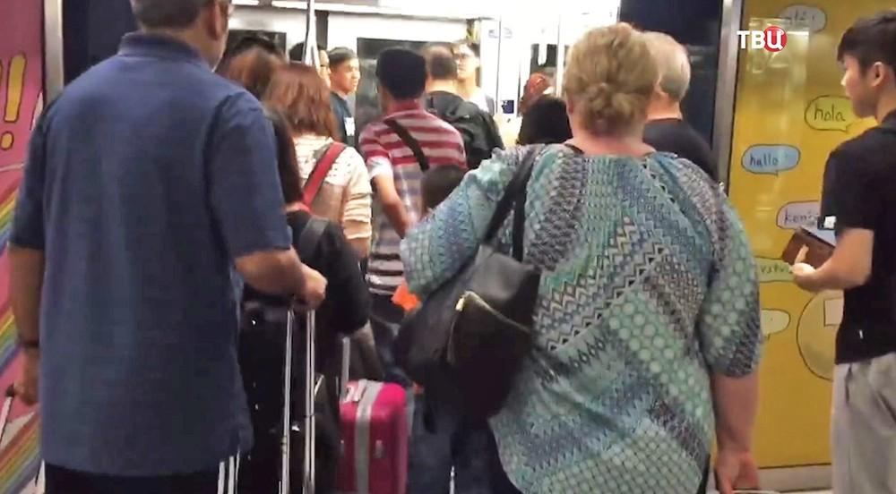 Туристы в аэропорте