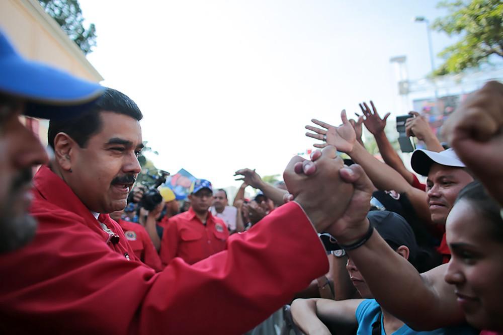 Николас Мадуро и жители Венесуэлы